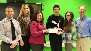 Foundation presents check to students