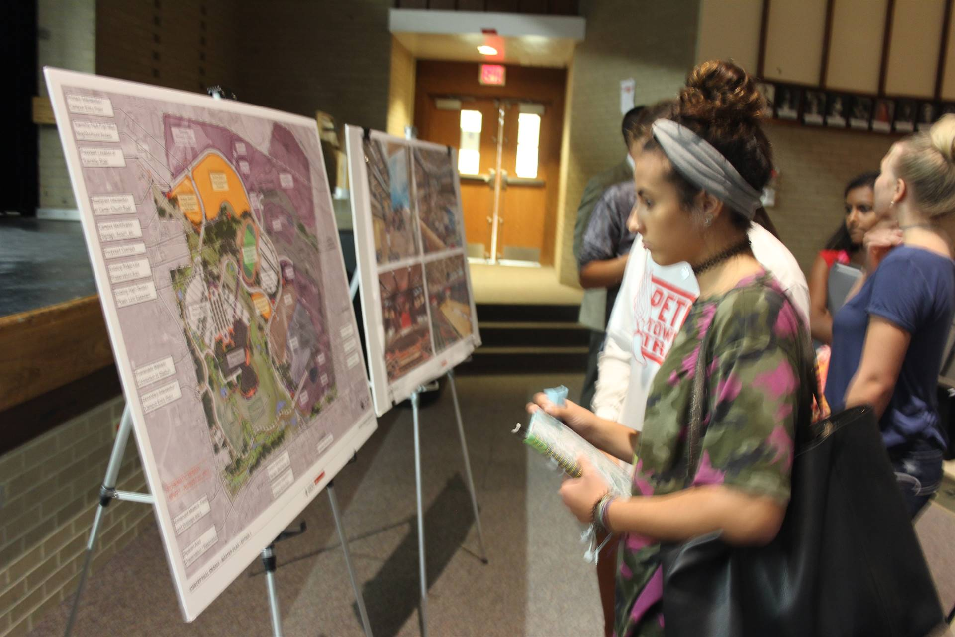 Student looks over site plan for the school.