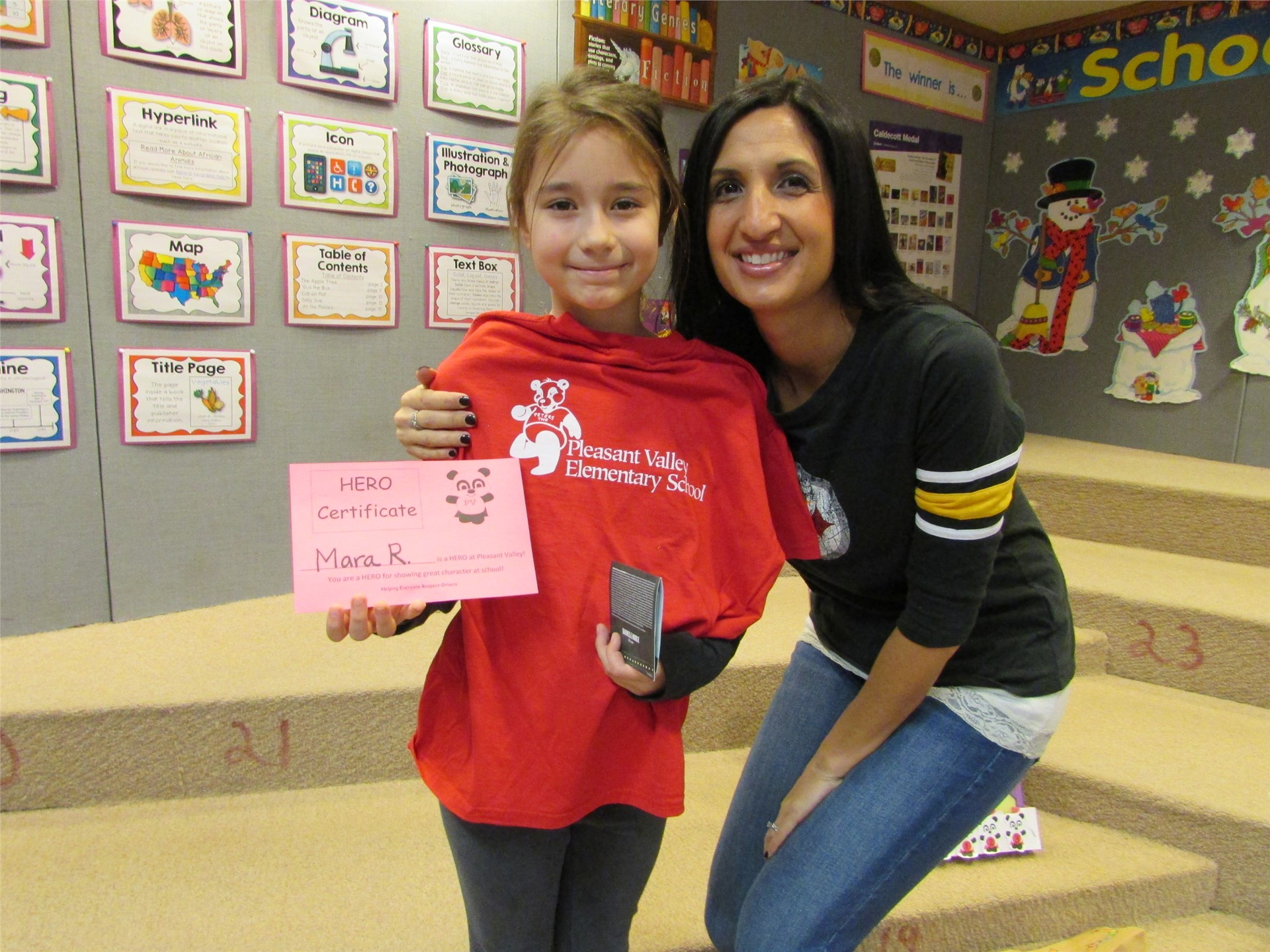 Mrs. Ali and one of our student winners