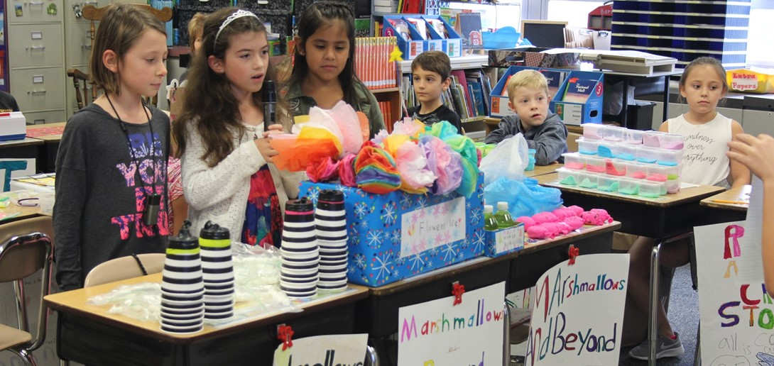 Students read their commercial during the mini mall event.