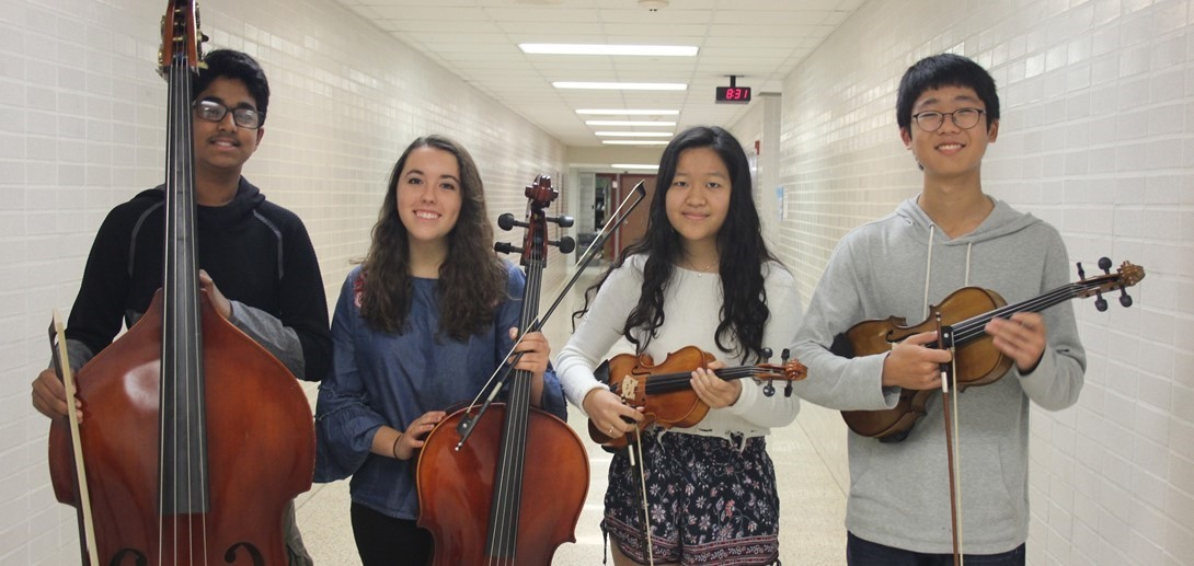 PMEA musicians pose with their instruments.