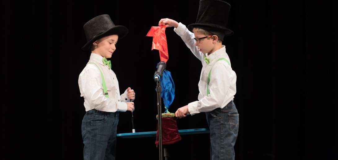Students performing a magic act at the show.