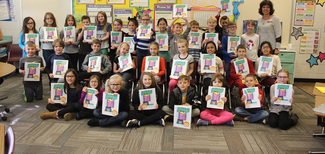 Student authors posed with copies of the book