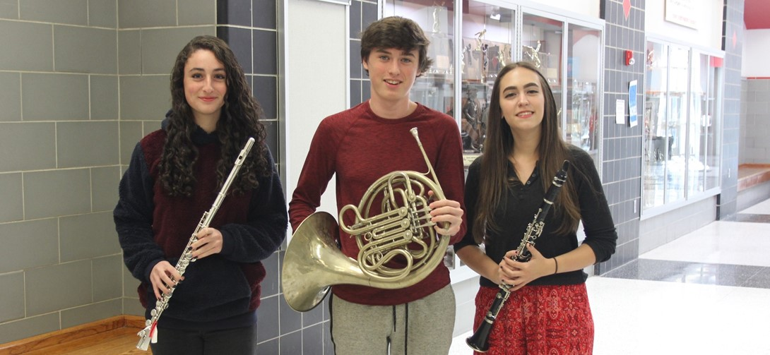 Student musicians with their instruments