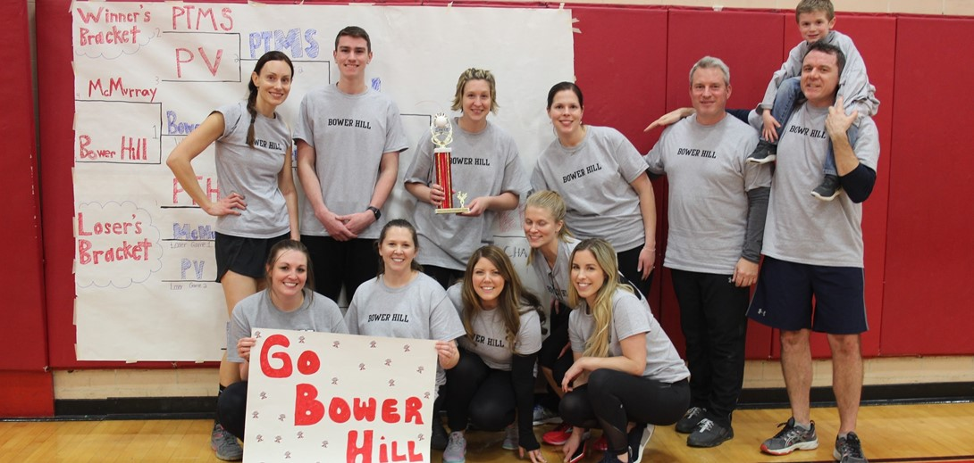 Bower Hill volleyball team members pose with the trophy.