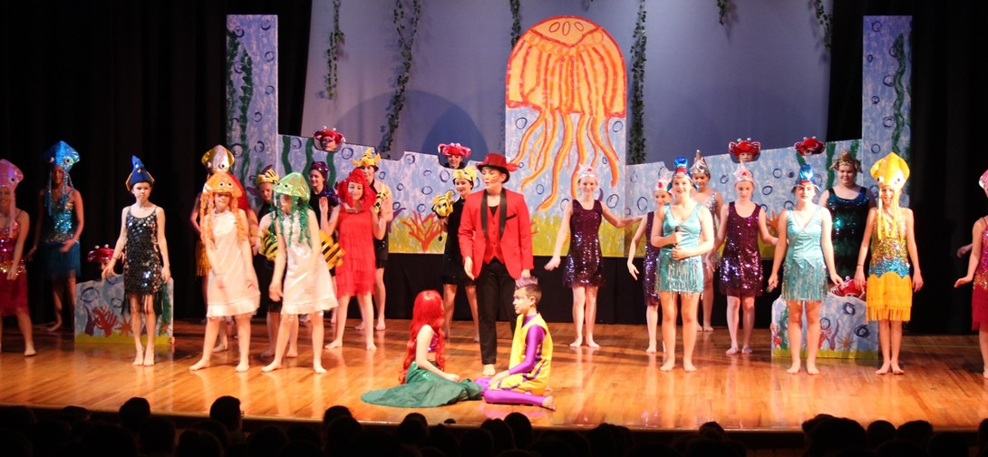 students perform Under the Sea during the musical.