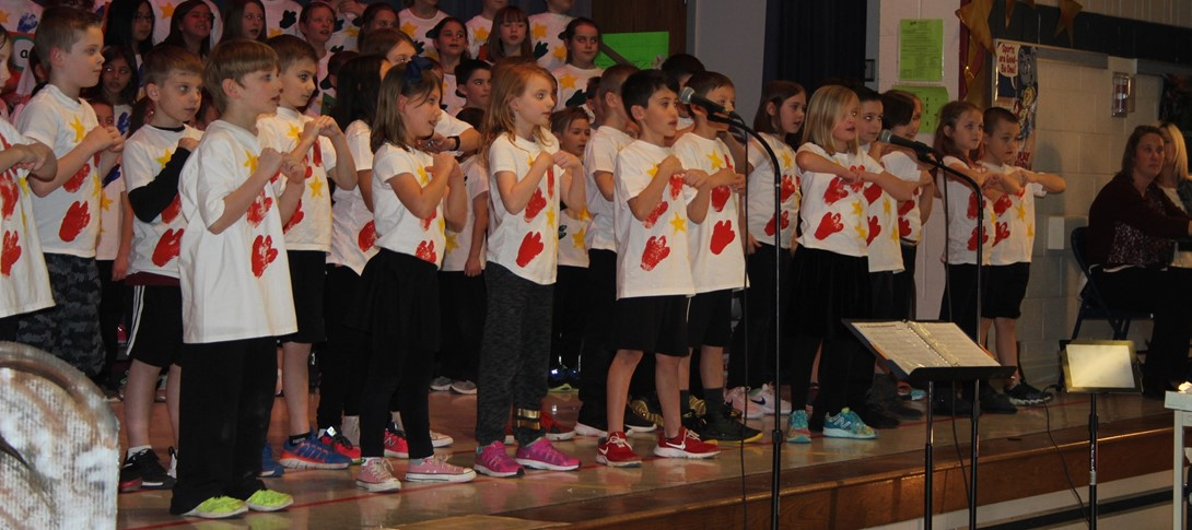 Students on stage performing Dinostars