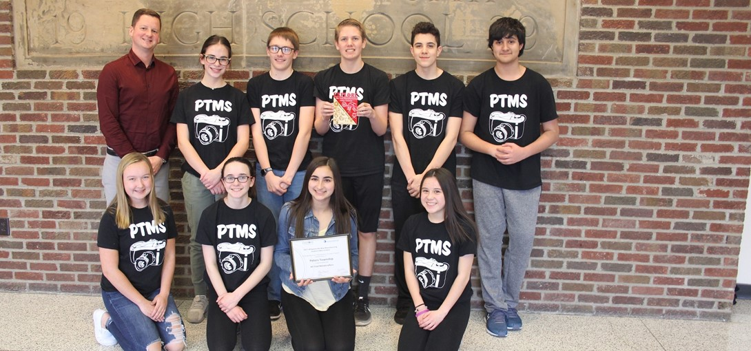 Students pose with their award from the contest.