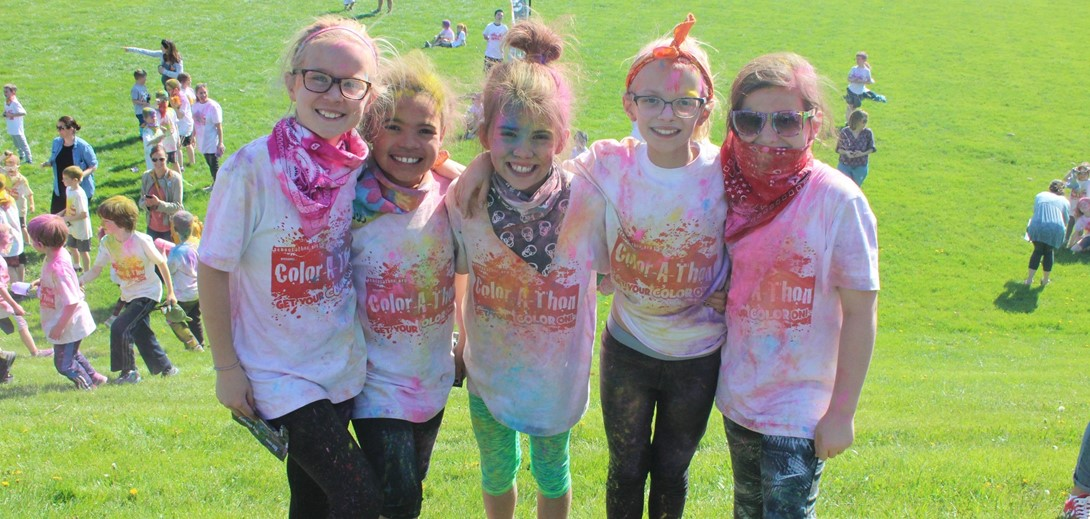 Students covered in color powder following the race.