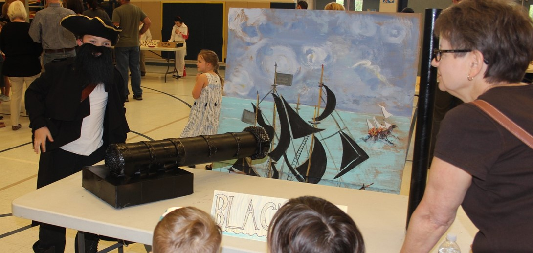A students dressed as blackbeard the pirate presents at Bio Time.