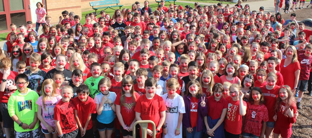 Students gather wearing their red noses.