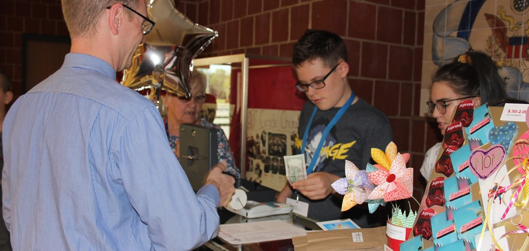 Students make their first sale in the student store.