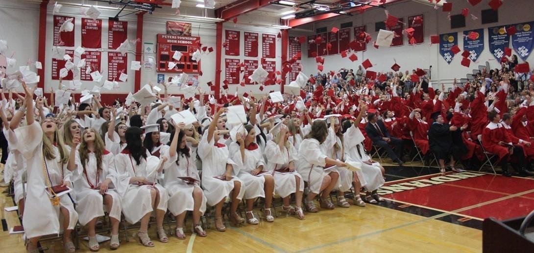 Graduates tossing their caps at graduation.