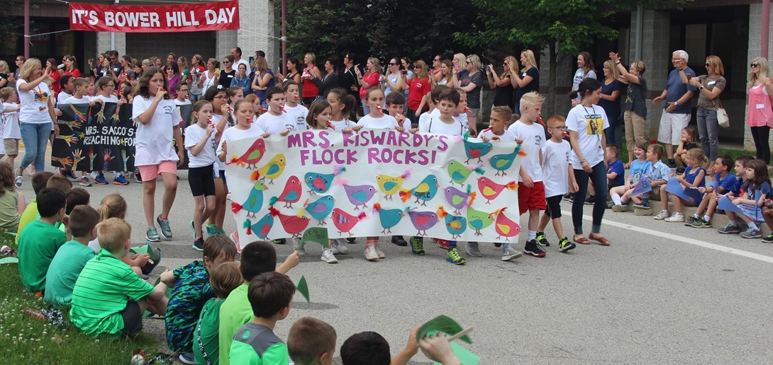 3rd graders march in the annual parade around the school.