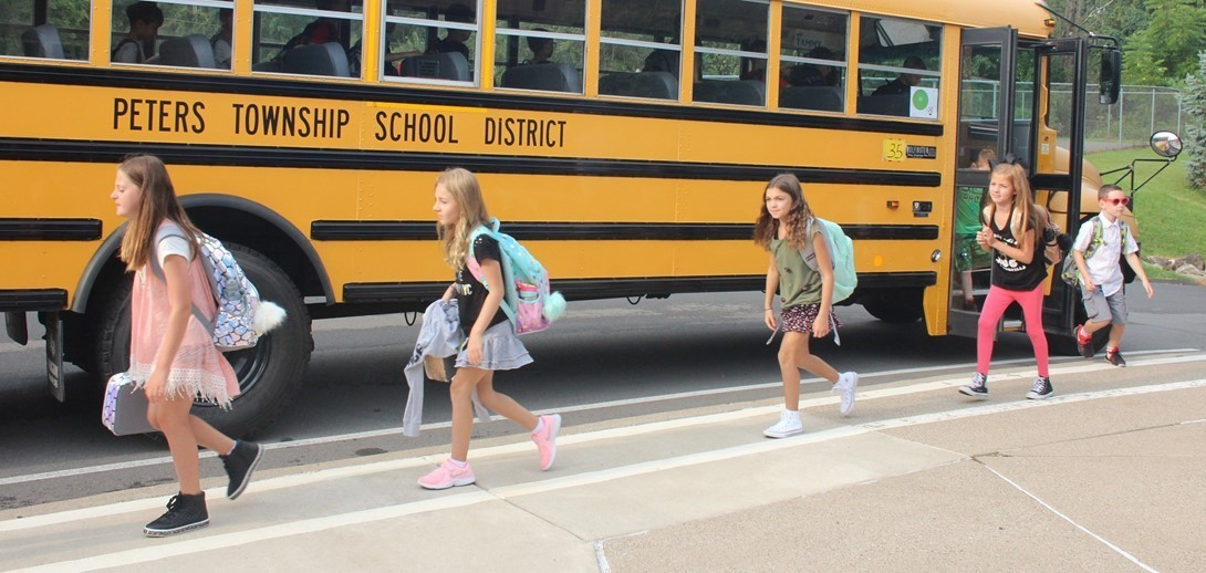 Kids arrive at Pleasant Valley on the first day of school