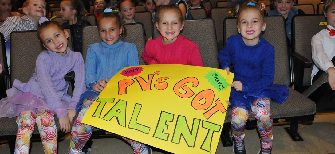 Students waiting to perform in the talent show.