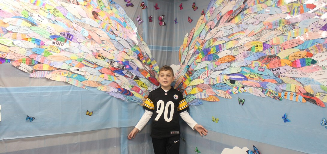 """A student stand in the """"wings"""" at McMurray Elementary."""