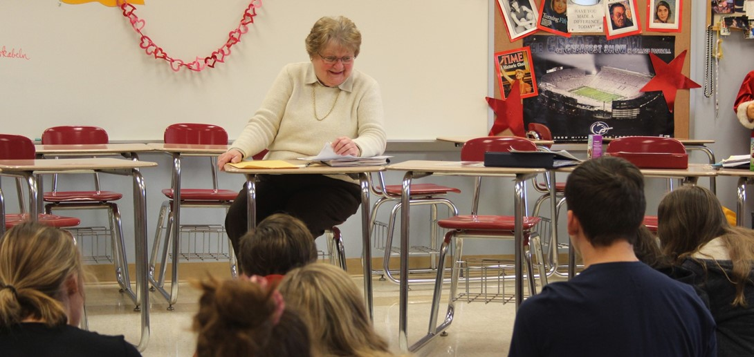 Authors speaks to students in social studies class.