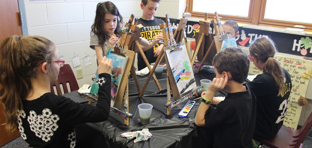 Students painting at easels