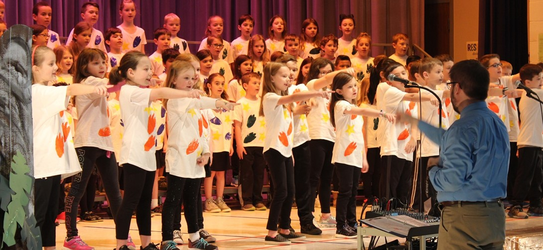 2nd grade students on stage singing