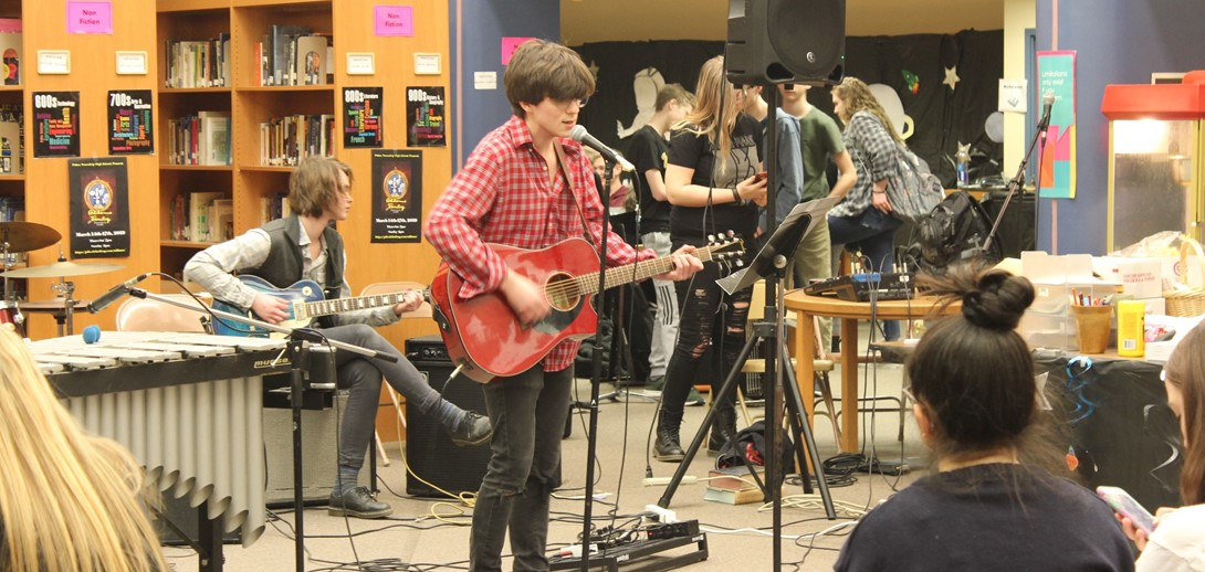 A student performs on Rock Band Day.