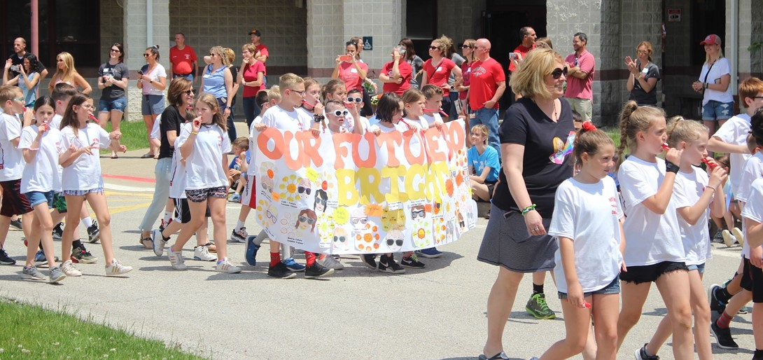 Third graders march in the parade.