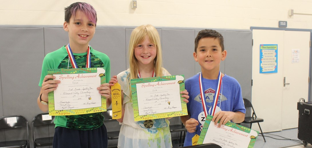 The three spelling bee winner with their medals.