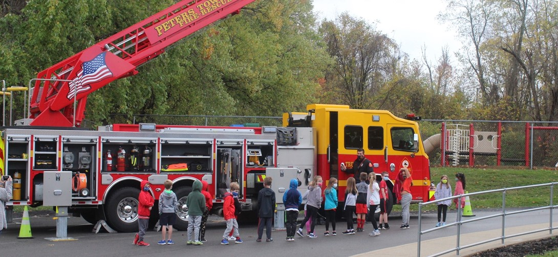 Student tour a fire truck at pleasant valley