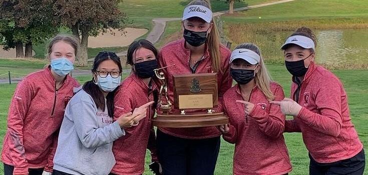 Girls golf team with WPIAL trophy