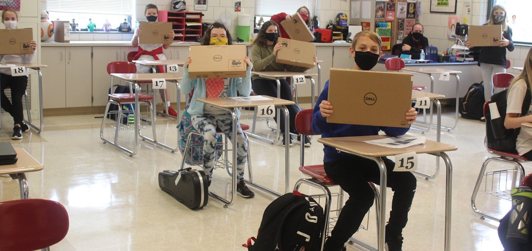 PTMS students with their new computers