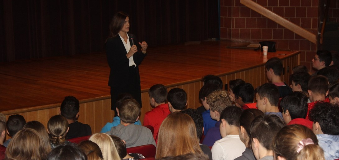 Natalie Mihalek talks with the students at the middle school.