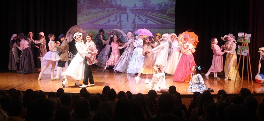 Students on stage during the Mary Poppins musical.