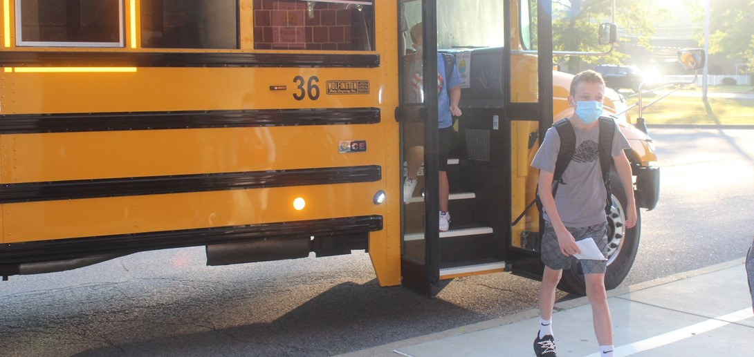 Student getting off the bus at PTMS