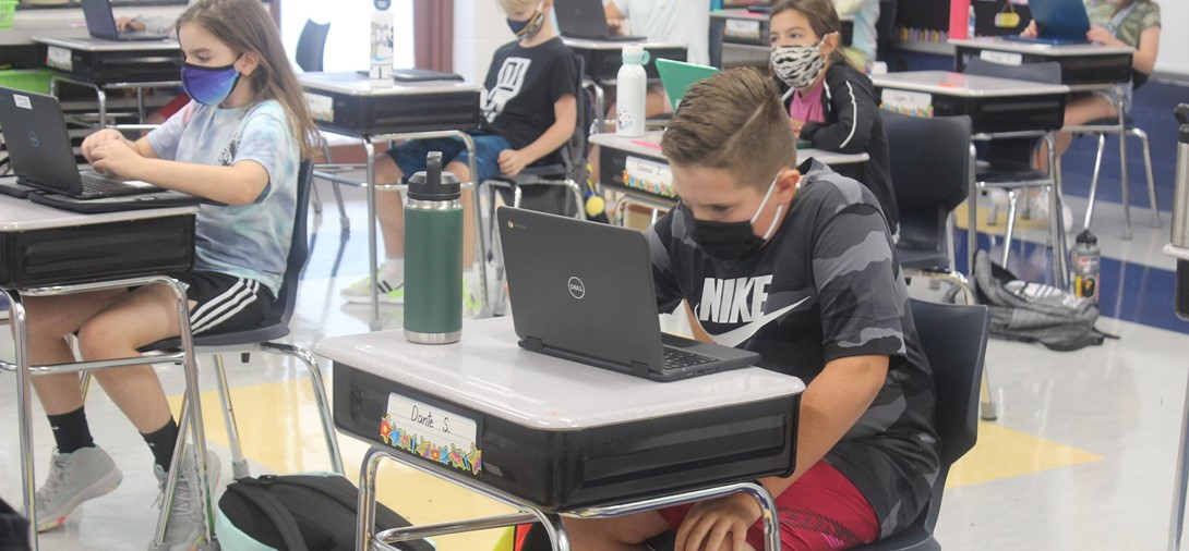 Students in Mrs. Oney's Class working on their chromebooks.