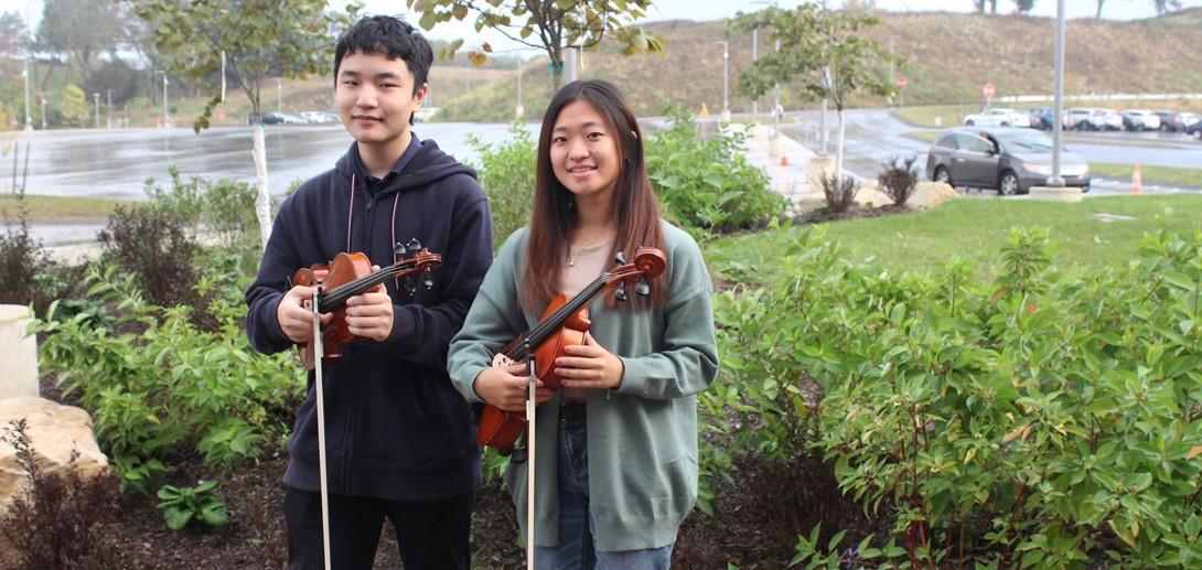 Senior James Wang (violin) and junior Anne Chang (viola)