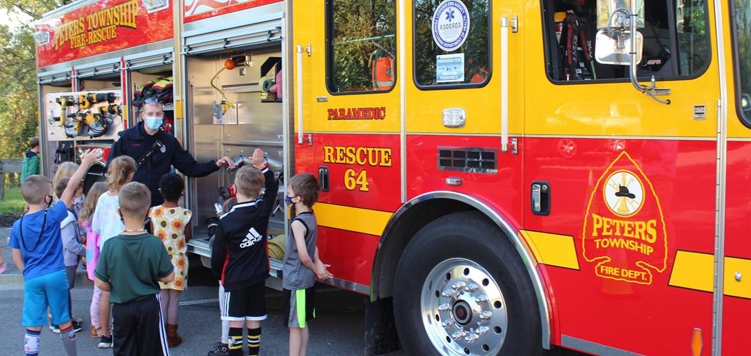 Kids tour a fire truck.