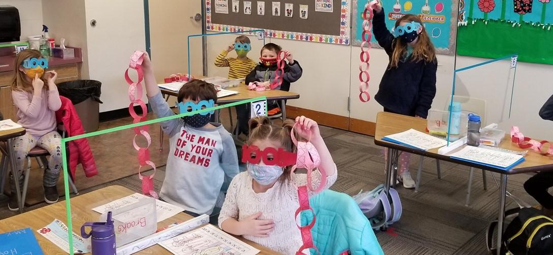 "Students wear ""100"" glasses."