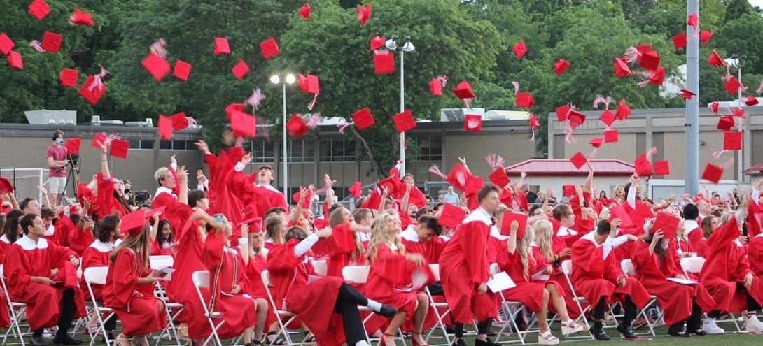 Graduates toss their caps