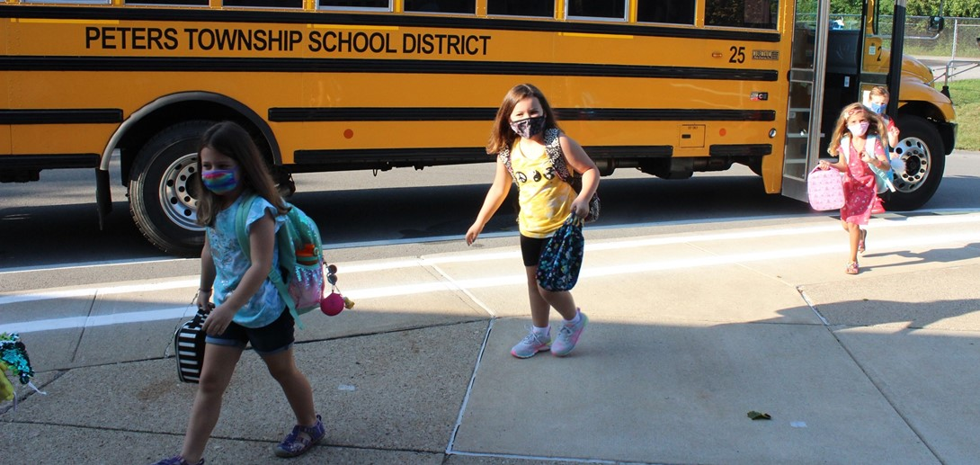 Students arrived off the bus on the first day of school