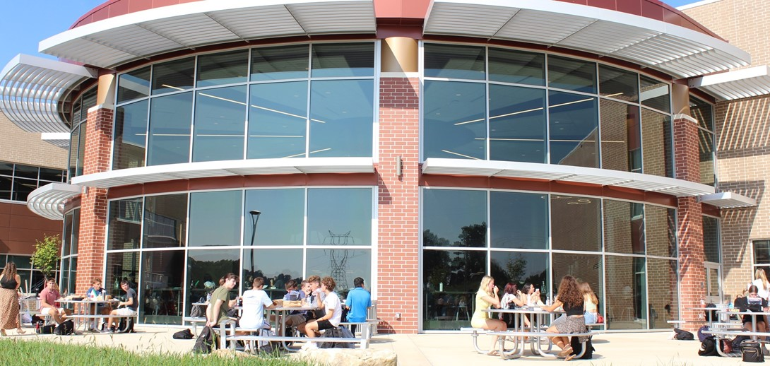 Students sitting outside on the patio at PTHS.