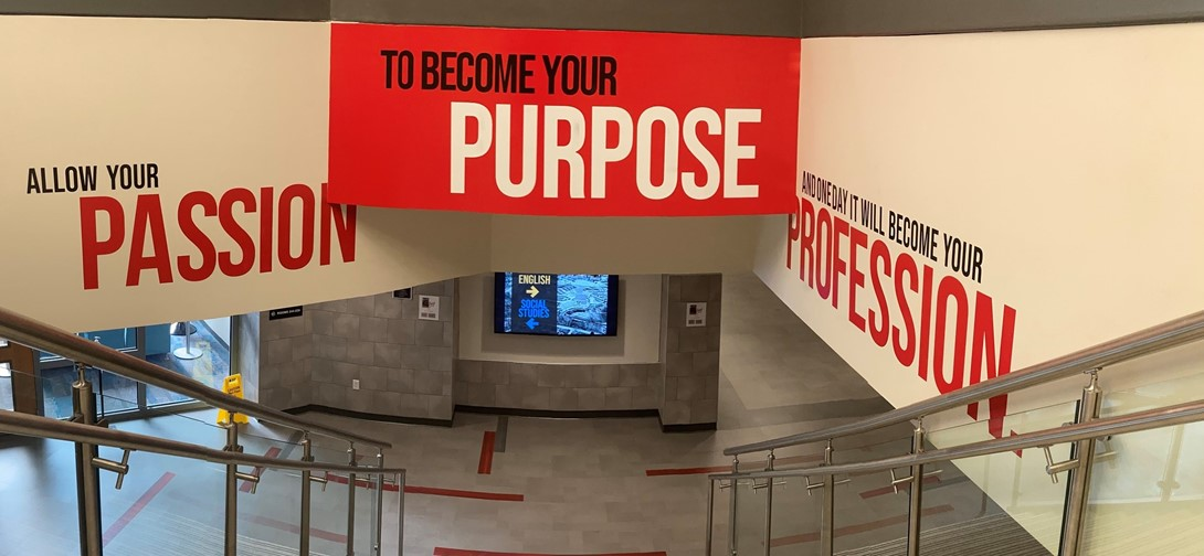 Branding signage in the main staircase at PTHS